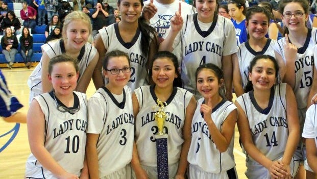 The Red Mountain Middle School seventh grade girls' basketball team capped an unbeaten season on the hardwood with a championship run in its post-season tournament. The Lady Cats were 18-0 this season. The team is, in no order: Coach Carlos Morales, Harmanie Dominguez, Briana Dominguez, Briana Flores, Madison McGinnis, Lily McMillan, Bianca Munoz, Mariah Pacheco, Lauren Rudiger, Alexis Terrazas, Nayeli Trujillo, Bianca Valverde and Megan Wertz.
