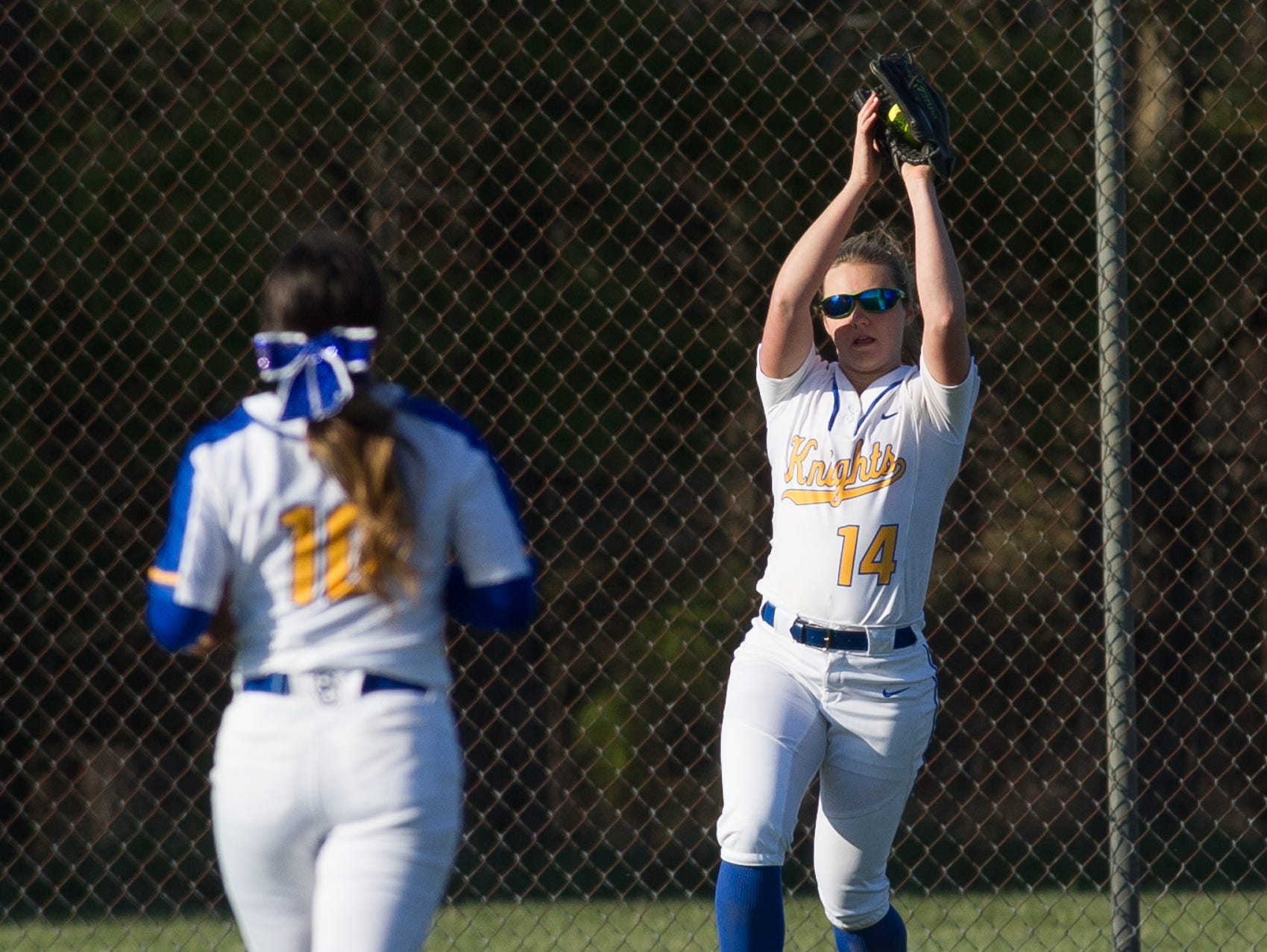 Sussex Central's outfielder Kasie Siimpson (14) makes a catch in their game against Sussex Tech.