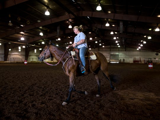 Sherri Trujillo works with her horse Easy Wednesday inside the beef barn at McGee Park.