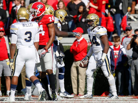 Georgia Tech running back Marcus Marshall (34) celebrates after a touchdown run in the first half of an NCAA college football game against Georgia, Saturday, Nov. 26, 2016, in Athens, Ga. (AP Photo/Brett Davis)