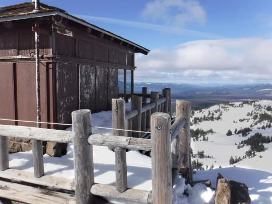 The Watchman lookout is seen at Crater Lake. Snowshoers