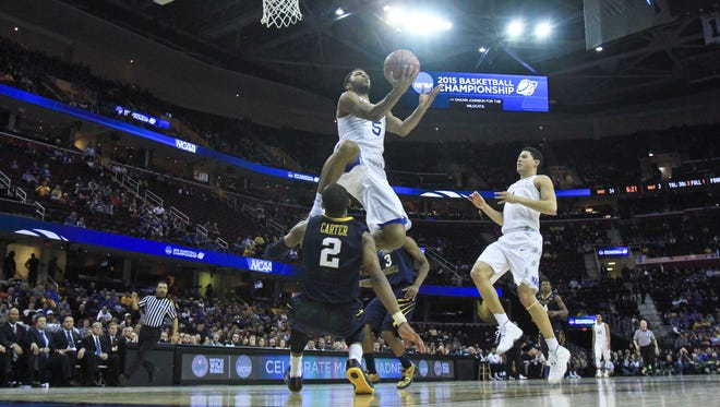 Andrew Harrison made this lay up and drew the foul late in the second half against West Virginia Thursday night in Cleveland.