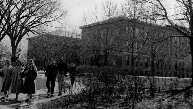 Students come down the walk from West High School in this 1956 photo.