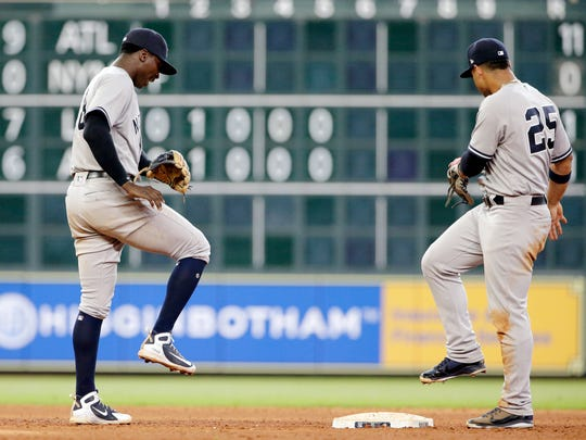 New York Yankees' shortstop Didi Gregorius (18) and second baseman Gleyber Torres (25) do a victory dance at second base after their 6-5 win over the Houston Astros in a baseball game Thursday, May 3, 2018, in Houston.