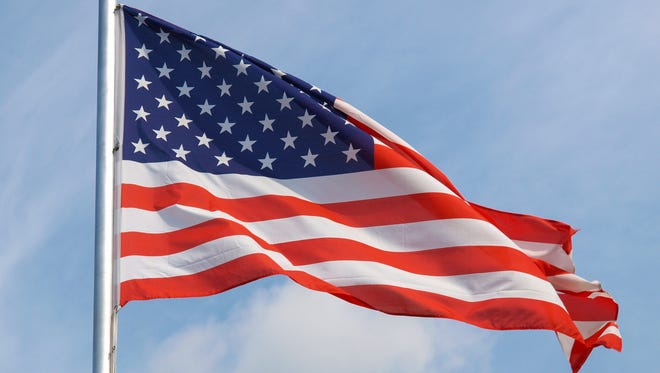 The national flag of United States, North America over blue sky