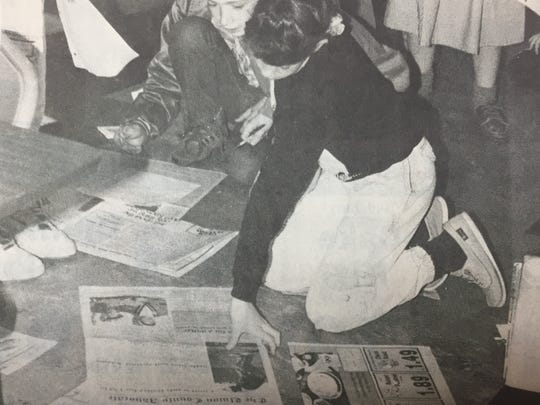 Allison Price, foreground, and Mike Wolfe, students at St. Ann's in Morganfield, used The Advocate for a project in March 1990.