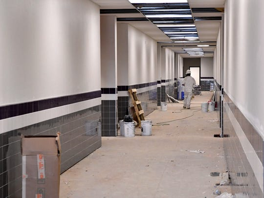 A worker walks down the hallway of Wylie East Elementary School Friday. The hallways have been designed to provide places to hide along the length with doors that open outward and not into the rooms.