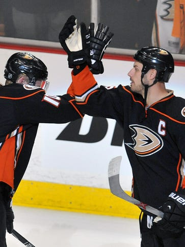 Anaheim Ducks right wing Corey Perry (10) and center
