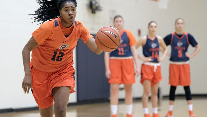 UTEP senior Sparkle Taylor dribbles up court during the team's first practice of the season in October at the Foster-Stevens Basketball Center.