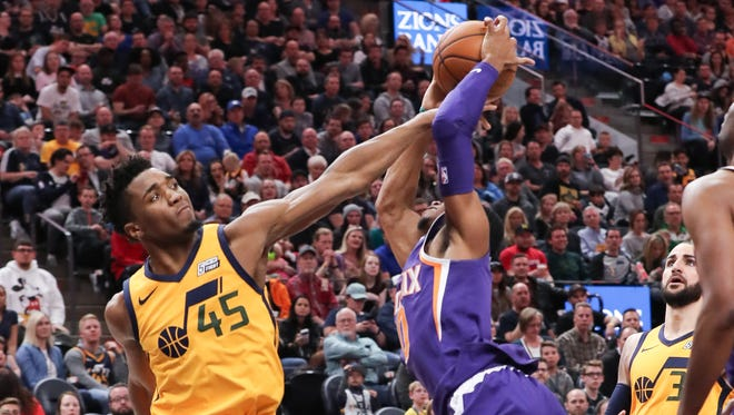 Mar 15, 2018; Salt Lake City, UT, USA; Utah Jazz guard Donovan Mitchell (45) blocks the shot of Phoenix Suns guard Shaquille Harrison (10) during the second half at Vivint Smart Home Arena. Utah Jazz won 116-88. Mandatory Credit: Chris Nicoll-USA TODAY Sports