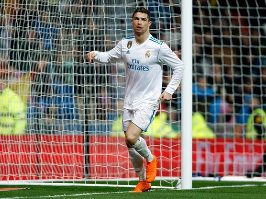 Real Madrid's Cristiano Ronaldo celebrates after scoring his side's third goal against Getafe during the Spanish La Liga soccer match between Real Madrid and Getafe at the Santiago Bernabeu stadium in Madrid, Saturday, March 3, 2018. Ronaldo scored twice in Real Madrid's 3-1 victory. (AP Photo/Francisco Seco)