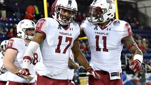 Temple players celebrate a touchdown at the Military