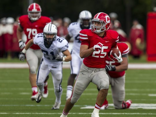 Senior running back Luke Hagy, shown in 2012 during Cornell's homecoming victory over Yale, rushed for 100 yards in each of the Red's final three games a season ago and is one of four captains this year.