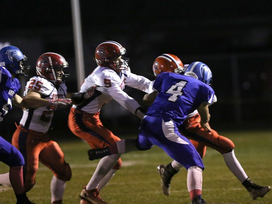 Despite massive losses to graduation in its Division 5 state title run last year, Amherst continues to feature a shutdown defense. See here, Amherst bulldozes during the game between Spencer/Columbus and Amherst at Amherst, October 28, 2016.