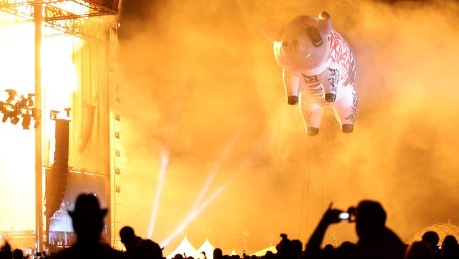 An inflated pig floats over the crowd as Roger Waters performs on the Coachella Stage during the Coachella Valley Music and Arts Festival at the Empire Polo Fields in Indio on Sunday, April 27, 2008.