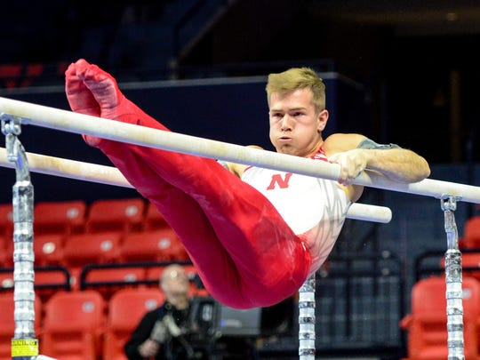 Nebraska's Chris Stephenson, of Fishers, competes on parallel bars at the 2017 Big Ten Championships.