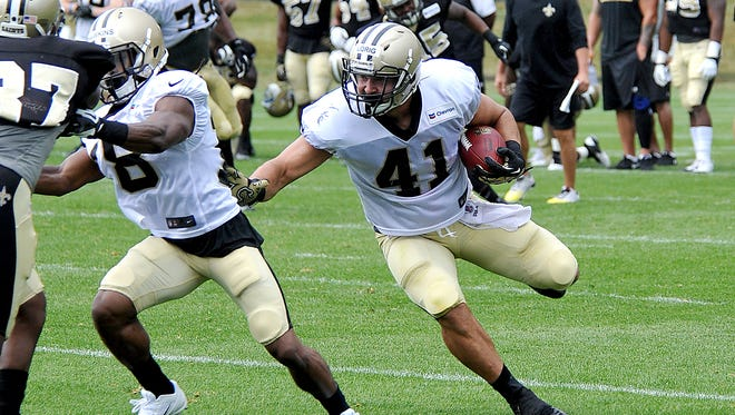 New Orleans Saints fullback Erik Lorig (41) runs the ball during there NFL football training camp in White Sulphur Springs, W.Va., Sunday, July 27, 2014.