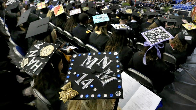 A sea of decorated mortar boards caps adorn the heads of many of those graduating from MTSU in May 10. More than 850 students will earn degrees during the Aug. 9 ceremony.