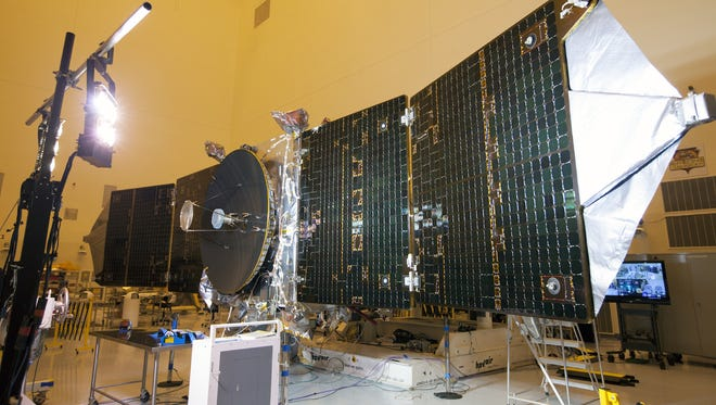 In October at Kennedy Space Center, special lighting was used to test the power-producing capabilities of the twin solar arrays on NASA's Maven spacecraft. The spacecraft is being prepared for a Nov. 18 launch to Mars.