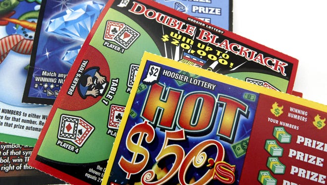 Hoosier Lottery scratch-off game tickets. A man who won $2 million from a scratch-off game while separated from his wife only has to give her 2.5% of the winnings, or $50,000, an appeals court ruled Wednesday, April 23, 2014.