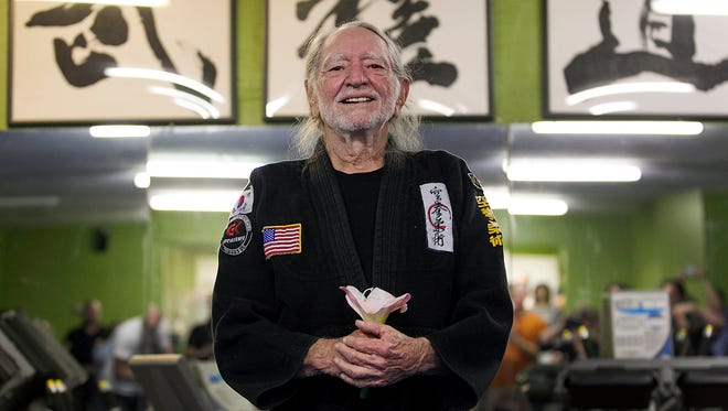 Willie Nelson smiles as he receives his fifth-degree black belt in the martial art of Gong Kwon Yu Sul on April 28 in Austin.