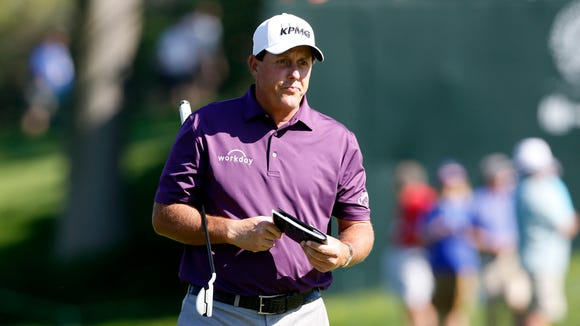 Phil Mickelson looks on while on the fourteenth green