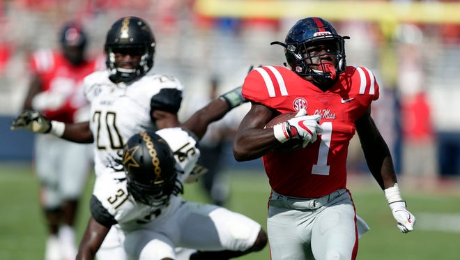 Mississippi wide receiver A.J. Brown (1) runs past Vanderbilt defenders for a 58-yard touchdown pass reception in the first half of an NCAA college football game in Oxford, Miss., Saturday, Oct. 14, 2017. (AP Photo/Rogelio V. Solis)