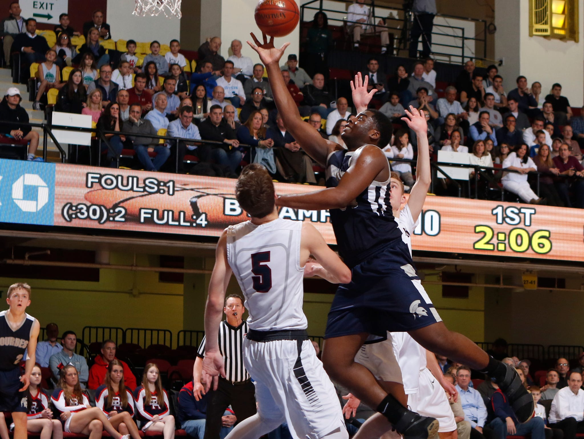 Our Lady of Lourdes High School's James Anozie takes a shot in traffic against Byram Hills in a Section 1 Class A semifinal on March 1 at the Westchester County Center.