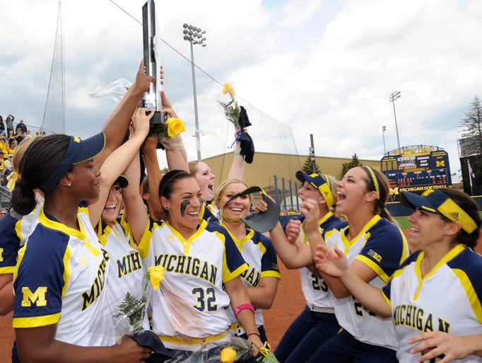 The Michigan softball players hoist their 2016 Big