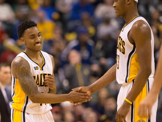 Jeff Teague (left), congratulates Pacers teammate Myles