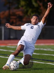 World of Inquiry's Frankie Santiago slides to keep the ball inbounds.