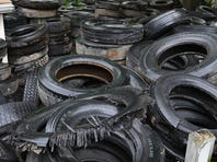 Tires fill the backyard of a home at 2510 W. Madison St., Springfield.