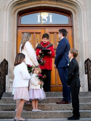 Lisa and Kyle Clark get married on the steps of City Hall in Birmingham.