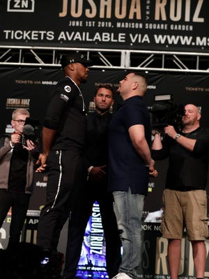 British boxer Anthony Joshua, left, faces off against Andy Ruiz on Thursday, May 30, 2019, in New York before a news conference ahead of their heavyweight bout Saturday. Joshua will defend his WBA, WBO and IBF heavyweight titles.