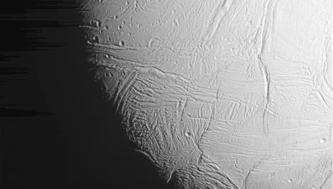 """This unprocessed """"raw"""" image of Saturn's icy, geologically active moon Enceladus was acquired by NASA's Cassini spacecraft during its dramatic Oct. 28, 2015 flyby in which the probe passed about 30 miles (49 kilometers) above the moon's south polar region."""