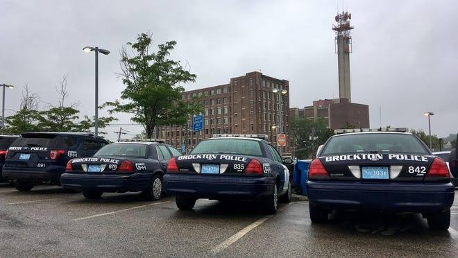 Brockton police cruisers parked outside the downtown police station on July 25, 2017.