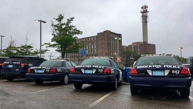 FILE - Brockton police cruisers lined up in the parking lot of the Brockton Police Department on Tuesday, July 25, 2017.
