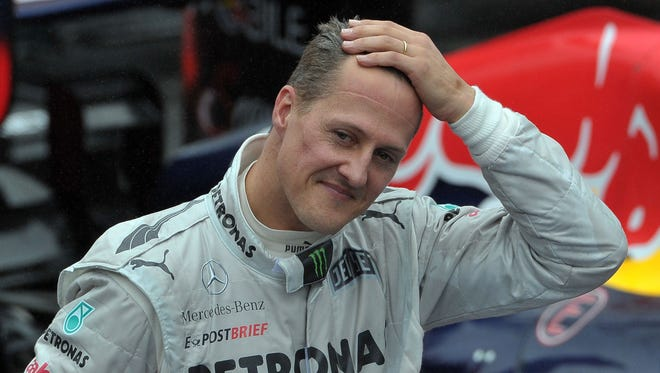 (FILES) A file picture taken on November 25, 2012 show German Formula One driver Michael Schumacher gesturing at the end of the Brazil's F-1 GP at the Interlagos racetrack in Sao Paulo, Brazil.