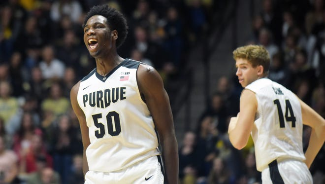 Purdue's Caleb Swanigan, left, lets out a yell after a made basket Frida  at Mackey Arena . The Boilermakers won 81-40.