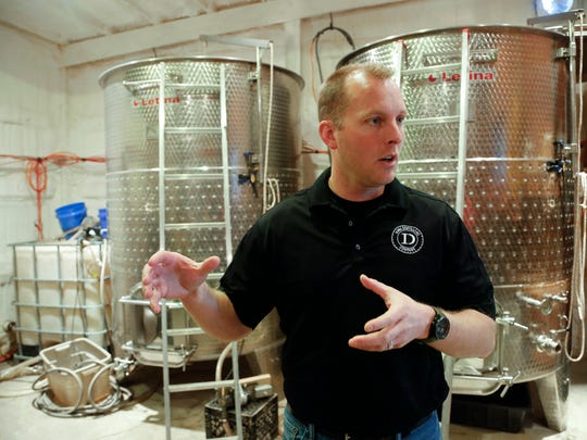 Todd Dunkel of Iowa Distilling Company talks about the distillation process Friday, March 27, 2015.