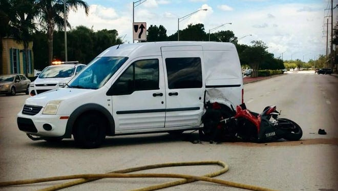 A motorcycle lies on its side after a crash Tuesday, June 27, 2017, in Port St. Lucie.