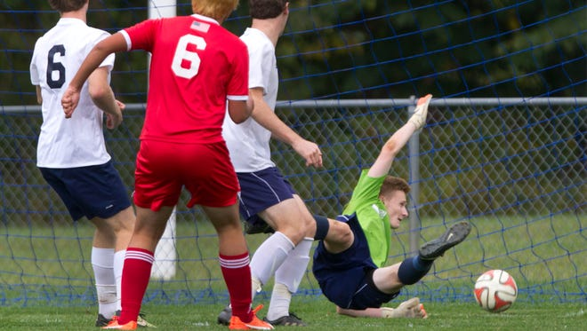 Manalapan's Pio Schiano-Lamoriello watches as he goal slips by CBA goalie Aedan Boriotti to put Manalapan up 1-0 early in the first half. Manalapan vs Christian Brothers Academy Boys Soccer on October 14, 2015.
