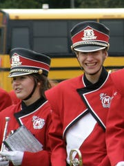 Sherry McMahon and Connor Madison in their Lincoln High School band uniforms, October 2009. The two started kindergarten together 17 years ago and graduated from UW-Oshkosh together last Saturday.