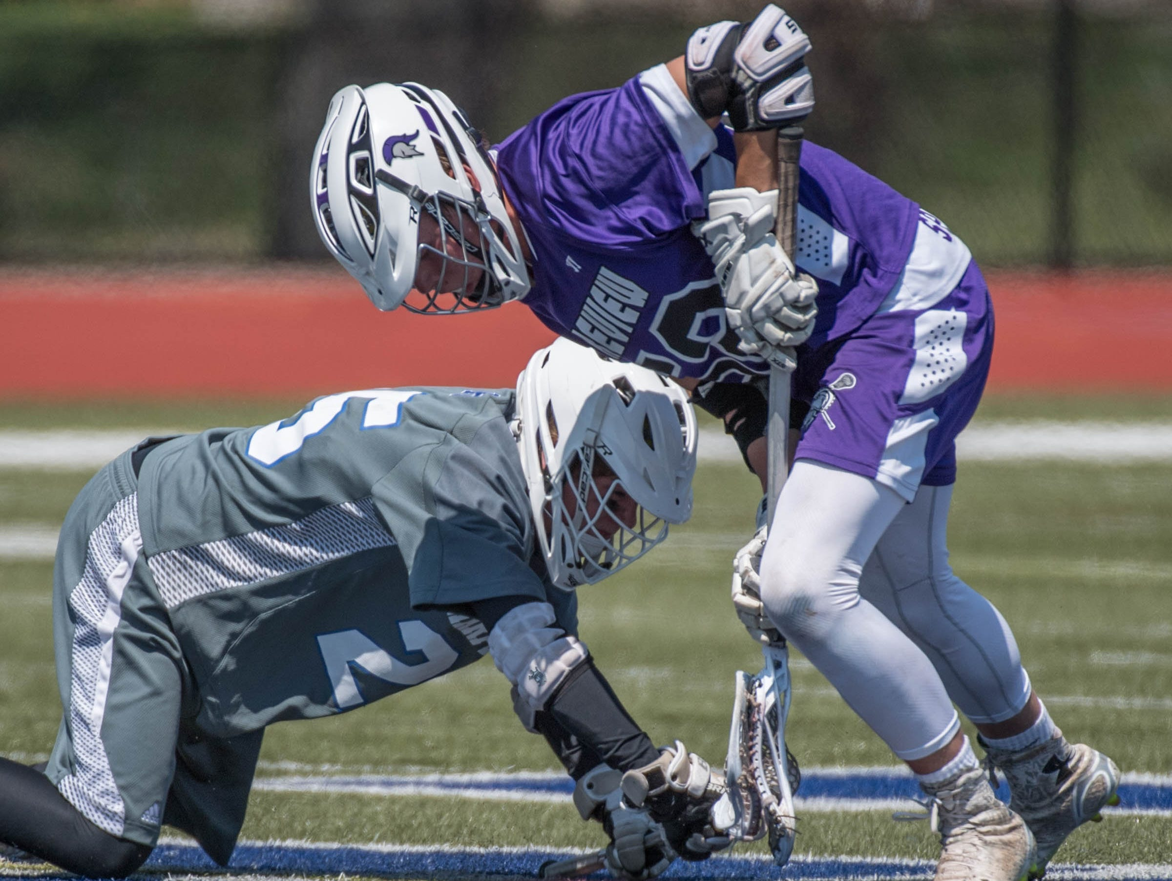 Lakeview's Jerry Haadsma (52) digs for the ball against Harper Creek's Alex Phillips (25) in the All City Lacrosse Tournament on Saturday.