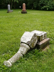 A toppled grave marker in the Funk Newcomer Cemetery