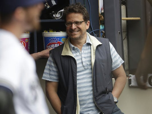 FILE - In this June 3, 2017, file photo, Milwaukee Brewers owner Mark Attanasio a baseball game against the Los Angeles Dodgers, in Milwaukee. Attanasio sets the tone each spring when he addresses the team on the first day of full workouts. The message this year should be upbeat with Milwaukee shifting from rebuilding to contending mode. (AP Photo/Morry Gash, File)