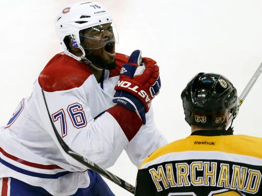 Montreal Canadiens defenseman P.K. Subban (76) reacts after getting hit in the face by Boston Bruins left wing Brad Marchand's stick during the second period of Game 1 in a second-round of a Stanley Cup playoff series in Boston, Thursday, May 1, 2014. (AP Photo/Charles Krupa)