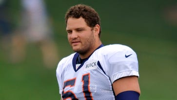 Titans add former Broncos center and a linebacker