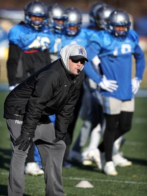 University of Memphis Coach Mike Norvell runs his team through practice drills at the  Billy J. Murphy Athletic Complex Tuesday morning as the team prepares for the upcoming Liberty Bowl against Iowa State.