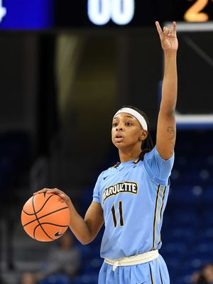 Marquette guard Allazia Blockton calls a play for her teammate.